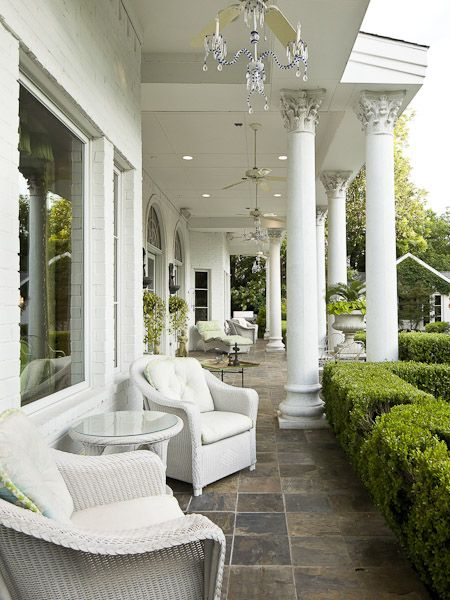 Lovely white porch with columns and chandeliers