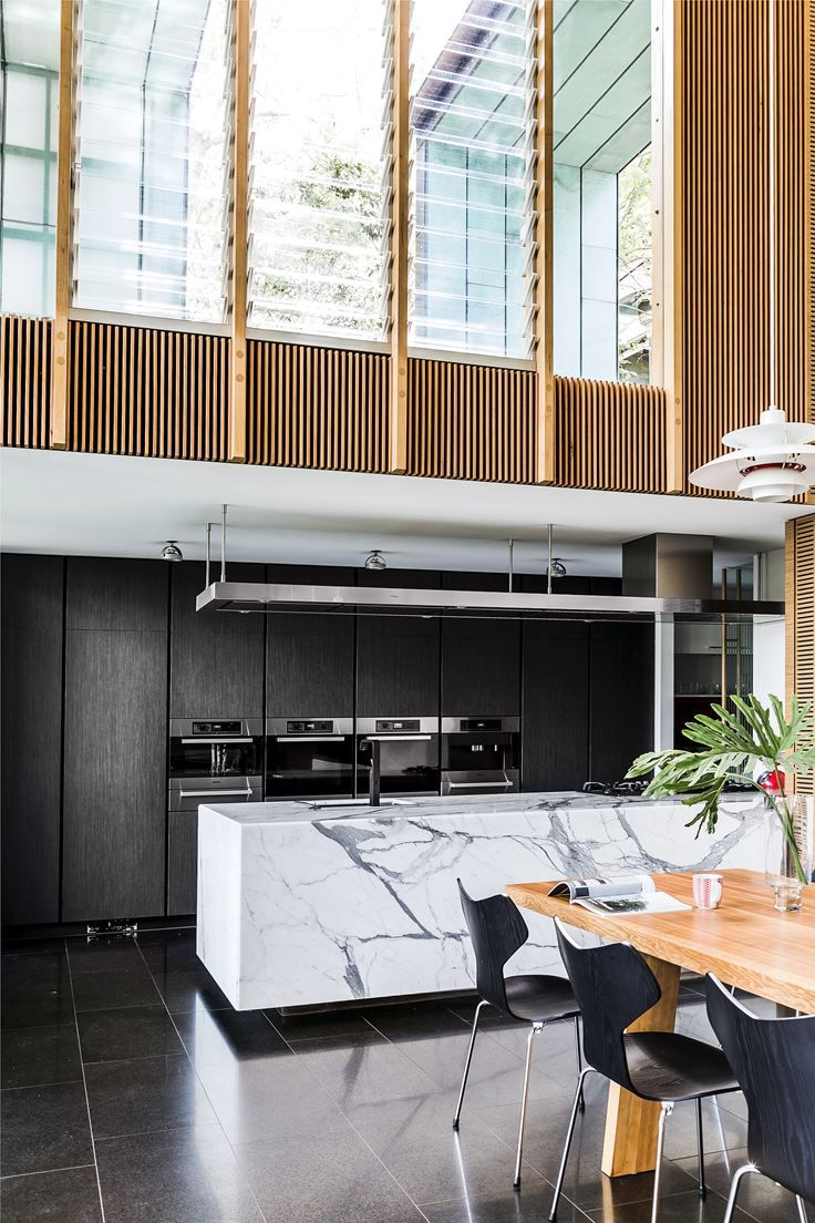 """A uniform wall of cabinetry, finished in a dark TrueGrain Anthracite veneer from [Briggs Veneers](http://www.briggs.com.au/?utm_campaign=supplier/