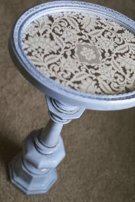 tall lampbase + picture frame = small pedestal table