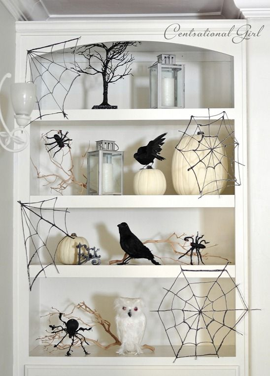 Spider webs made from glue, wax paper, and black glitter.