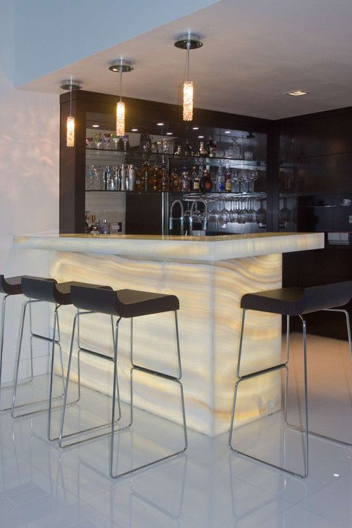 Home Bar by Umber Architecture, LLC | onyx | lights | translucent stone | luxury living | bar stools | home decor | interior design | contemporary home bar |