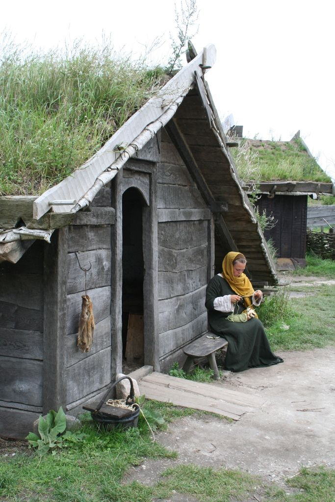 Viking house and woman, Fotevikens Museum, Sweden