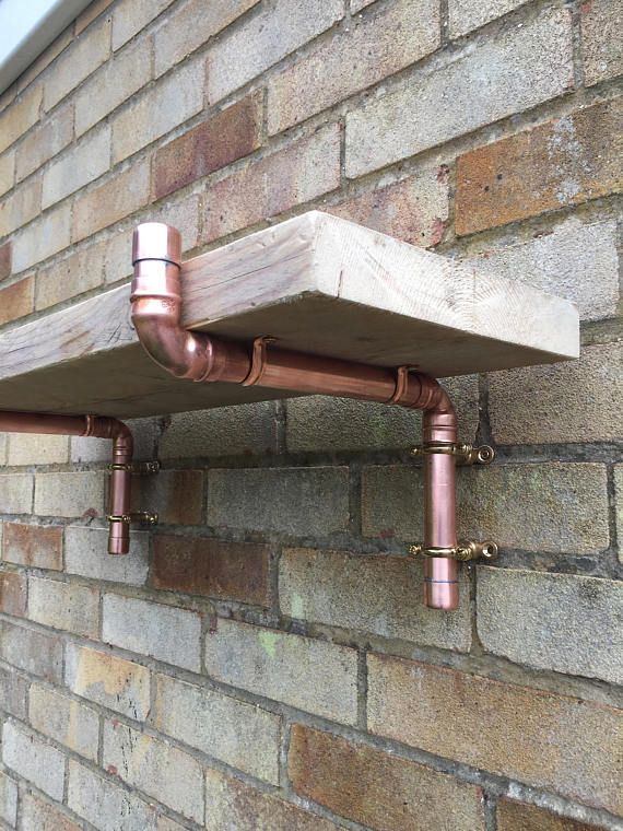 The Level Neville scaffold board shelf bracket is hand made using 22mm copper pipe. All fittings have been soldered to create a sturdy and unusual piece of functional art. Please note the wooden scaffold board is not included and only appears to show the finished item. You can create a bespoke shelf using what ever length of standard scaffold board you need, I would recommend placing each bracket no more than 1 meter apart! The brackets are supplied in pairs and come complete with wall…