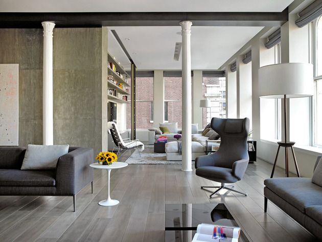 Classical Columns And Naked Concrete Walls Mix In Trendy NY Loft
