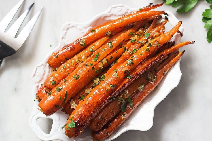 Honey garlic butter roasted carrots are so easy to make and delicious! With a pinch of cracked black pepper and Kosher salt, it makes the perfect side for a weeknight meal or a holiday crowd. Ingre…