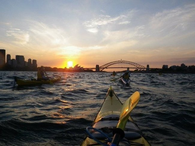 kayakers at sunset on Sydney Harbour. Picture: Tourism Australia