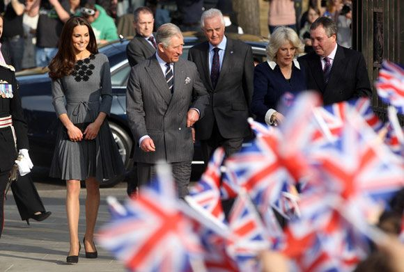 Kate, looking stunning in a grey Orla Kiely dress, joins Charles and Camilla, fresh from her afternoon hockey session with Team GB athletes.