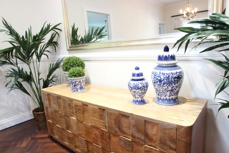 Blue & white ginger jars and some greenery freshen up the room