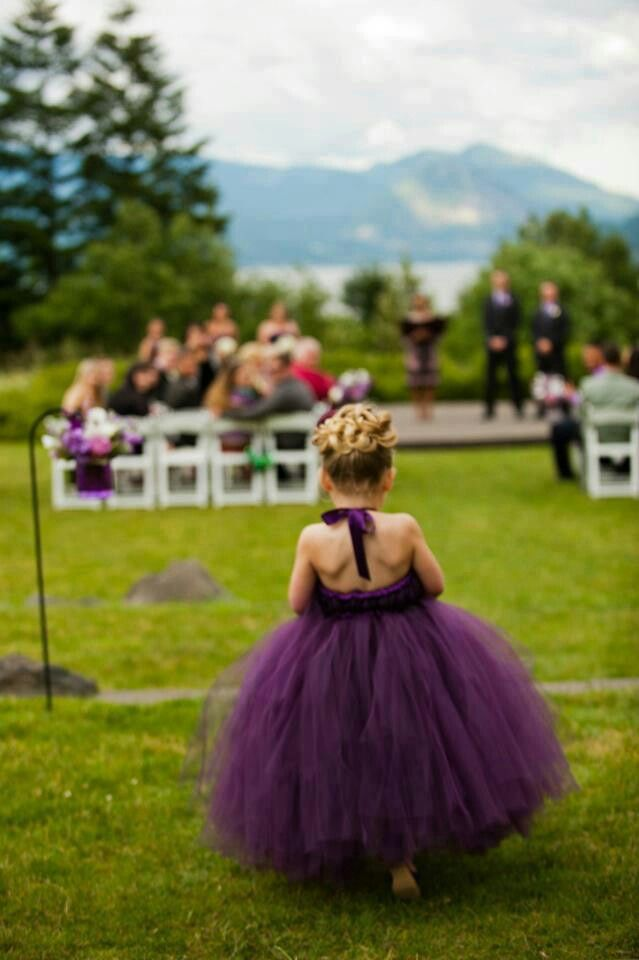 Soooo cute! And would perfectly match the bridesmaid dresses. She just needs her plum and green flower pedals to throw now.