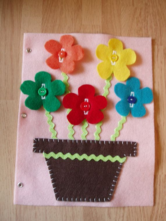"""Practice button skills with these cheery, colorful flowers. This 8 ½"""" x 11"""" felt page fits easily into most standard 3-ring binders or one of our fun"""