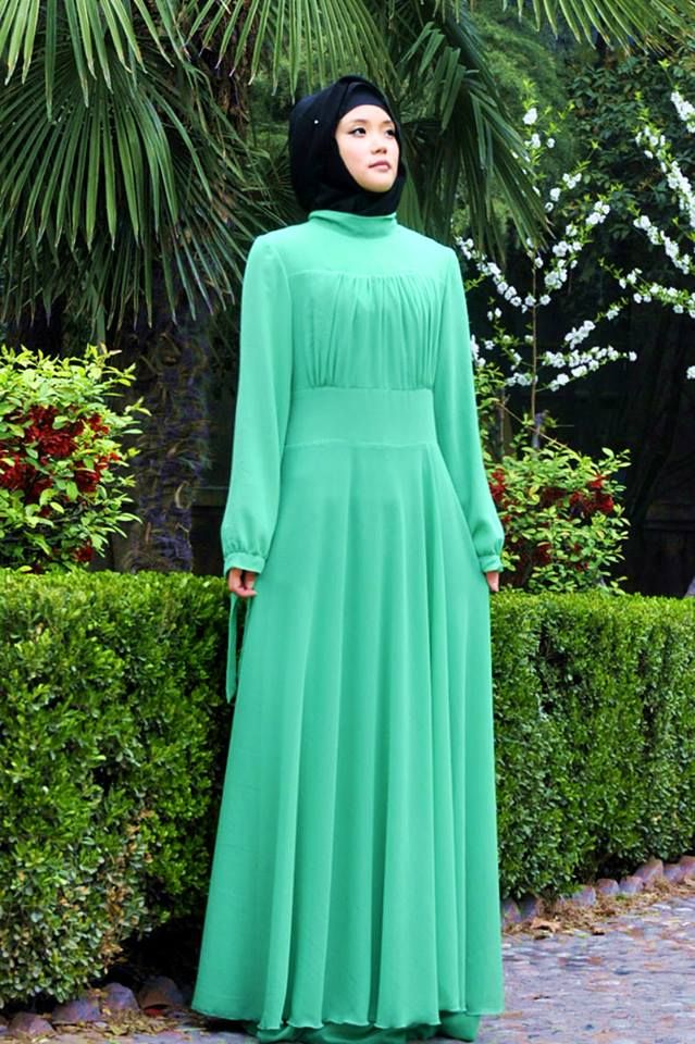 "I love the hijab style, the abaya, long sleeve maxi dress, the mint green colour of the dress, the pose of the model.. Modest dress. Muslimah fashion. The dress can be worn, front to back or back to front. Available on mode-sty.com . $37.99. Enter the code ""ColouredAbaya"" at checkout for free shipping worldwide."