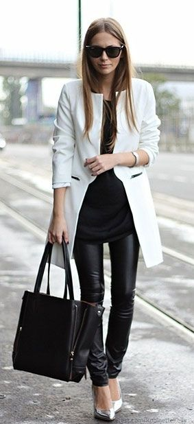 LOVE the long black sweater, pleather pants, white coat and heels...