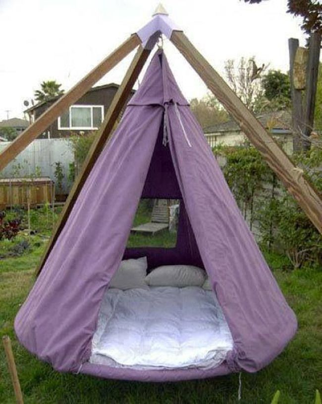 Repurposed old Trampolines into a hanging Teepee Beds (Pictures)