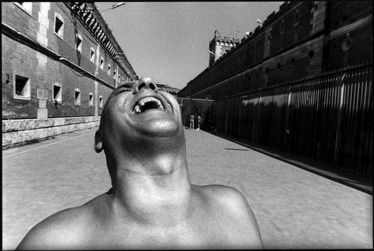 Name: Alex Majoli Nationality: Italian Born: 1971 This close up photograph of a man laughing gives a sense of humour to the photo. The diagonal lines created by the buildings draw your eyes towards the man which works very effectively.
