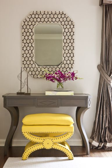 ~yellow leather ottoman with studded trim underneath a lovely console & mirror~Massucco Warner Miller