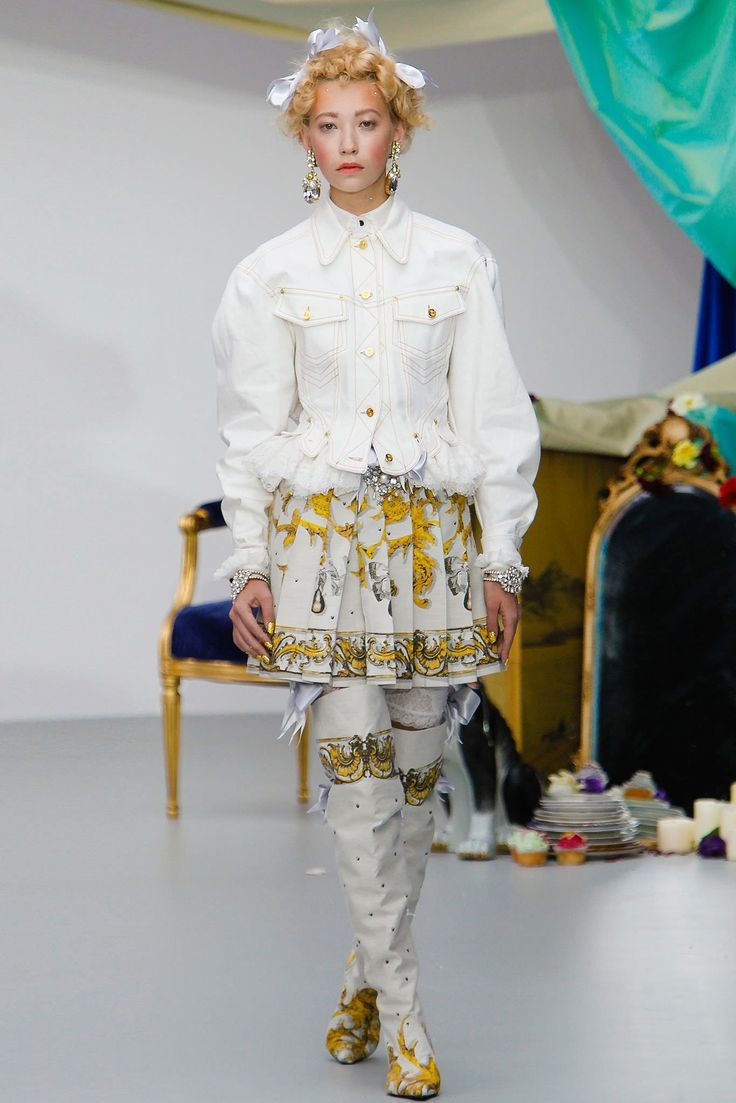 Meadham Kirchhoff, Spring 2014 I remember feeling that maybe I'd tumbled down some fairy-tale rabbit hole and into a wonderland of Rococo delights during this show. The fashion was totally otherworldly and decadent—if Marie Antoinette were around today and living in trendy East London, she'd surely have her fill here—but also laced with a cheeky punk attitude that was so right, and so Meadham Kirchhoff. I'm still kicking myself for not getting one of the corseted denim jackets!