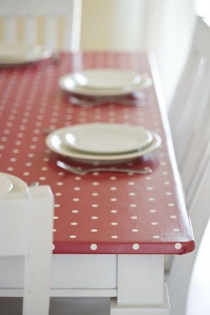 oilcloth table top.  The playroom table has seen better days.  This looks to be the perfect way to spruce it up again.