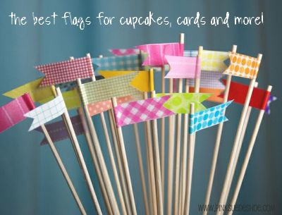 Washi Tape Cupcake Flags  1)Place cocktail stick on piece of washi tape leaving space either side then bend on side other to the other and to shape!Easy