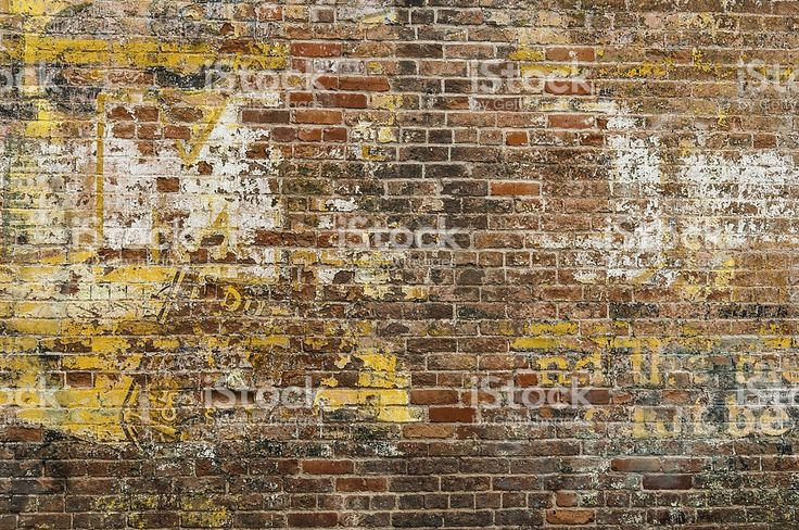 Faded Advertisement on a Brick Wall royalty-free stock photo