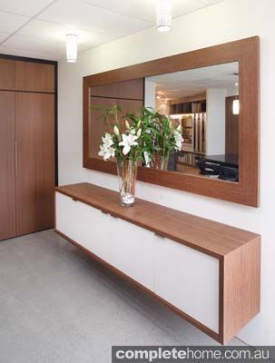 A clean timber and white storage unit