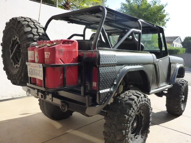 """Ford Bronco early Ford small SUV with """"Jerry cans"""" on back"""