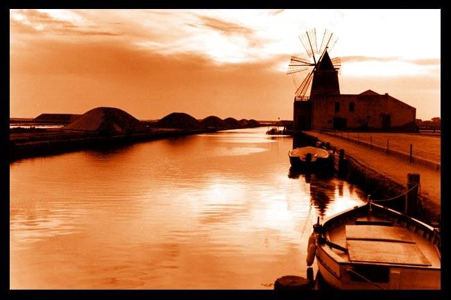 Sunset in Sicily, over the Marsala coastline. Marsala, Province of Trapani , Sicily region Italy