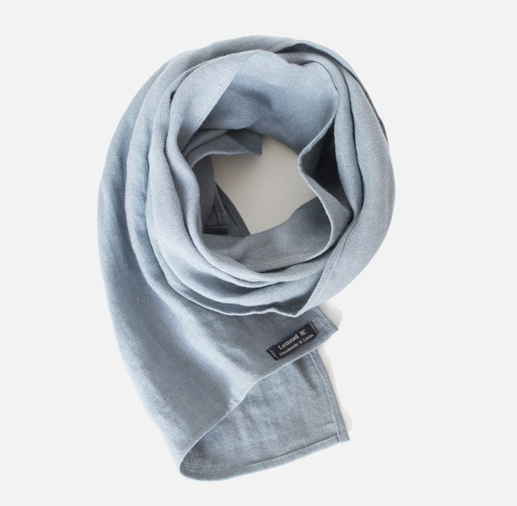 LINEN SCARF in light blue by LEMUEL MC This unisex scarf is handmade in London, from 100% Baltic linen, with  love and with attention to detail. Please note that, as all of our product are cut and sewn separately, measurements could vary slightly, from one item to another. Sizes: 35(45) cm x 155(65) cm