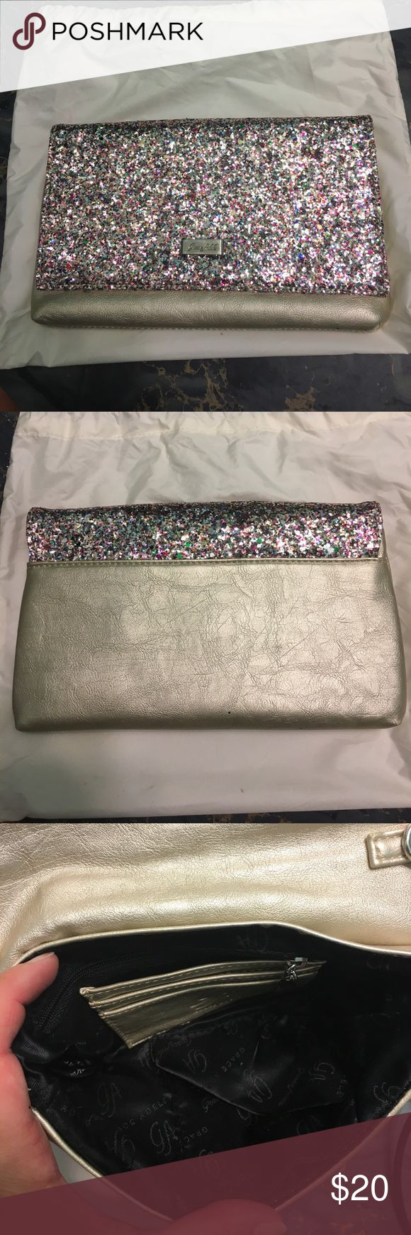 Glitter Clutch This super sparkly glitter clutch has never been used! It's so sparkly and pretty! Made by Grace Adele and comes with a chain! Perfect for any dress up or dress down occasion! Grace Adele Bags Clutches & Wristlets