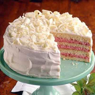 A white chocolate cake with raspberry filling and white chocolate frosting is perfect for entertaining.