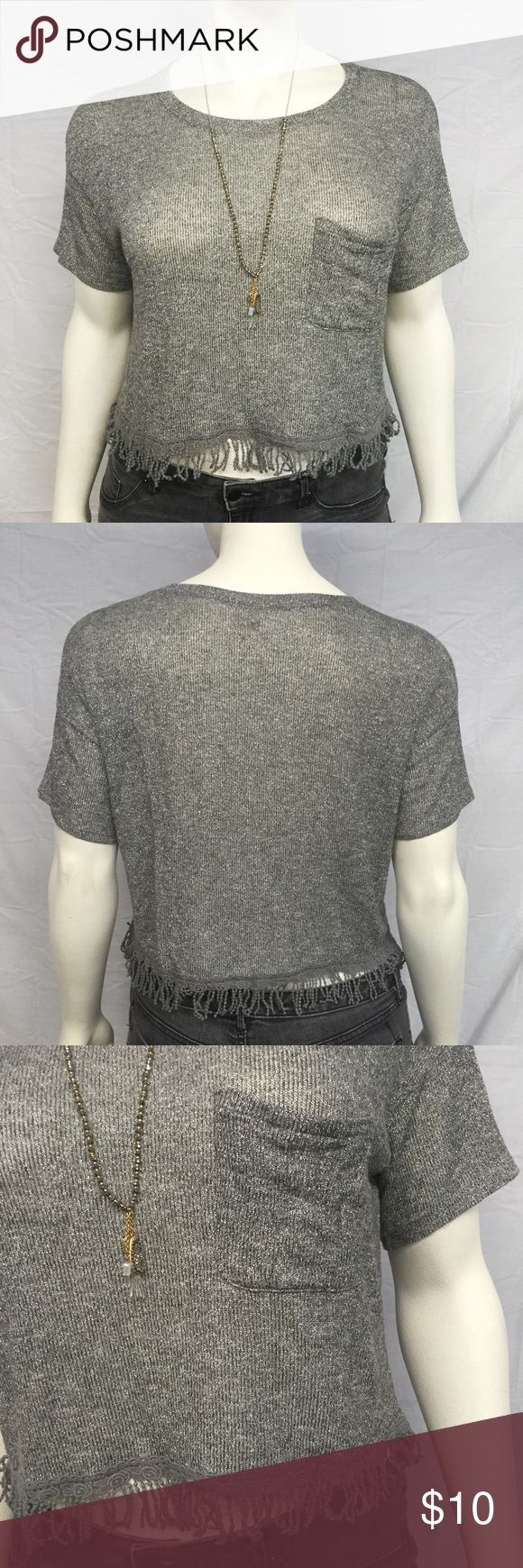 """Hollister Silver Crop Top Cute Hollister crop top with a fringed hem. Fun metallic silver fabric. Left breast pocket. Looks great with high waist black cut offs and strappy sandals! In excellent preowned condition with no damage or wear. Smoke and pet free home. Runs large and is stretchy. 44"""" bust. 20"""" long with fringe. 1 1/2"""" fringe. Hollister Tops Crop Tops"""