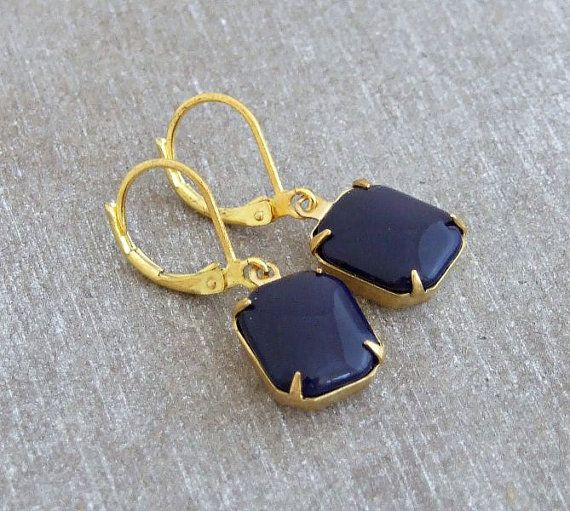 These lovely earrings feature vintage glass drops in an opaque navy blue and with an octagon shape. The drops are securely placed in brass settings and hang from gold plated ear wires  Glass drops are 12 x 10 mm Full length of earrings is 30 mm (approx 1 1/4 inches)  To see our full range of earrings please click here http://www.etsy.com/shop/beadishdelight?section_id=11021238  Any questions, please ask  Thank you for visiting Beadish Delight