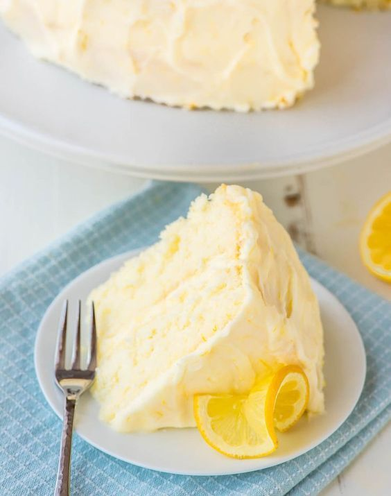 This Lemon Cake Recipe tastes like sunshine on a plate! Moist, fluffy and bursting with bright lemon flavor. Slathered in Lemon Cream Cheese Frosting and so dang good! @Well Plated