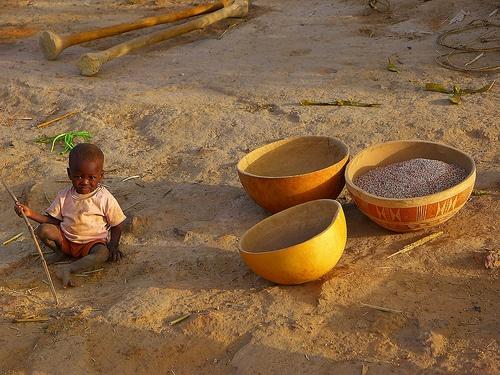 Child waiting for grain