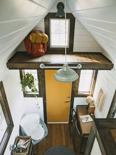 Peek Inside This Luxury 192-Square-Foot Farmhouse...they incorporated top-of-the-line materials (hardwood floors), fixtures (aged bronze barn-style sconces), and finishes (hand-hewn pine beams), creating an affordable housing option that doesn't skimp on style or quality.