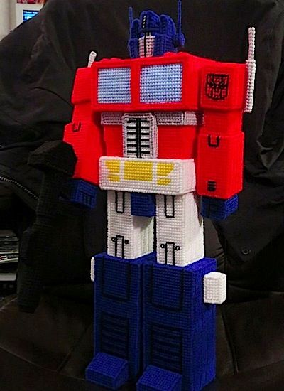 Tony Tuski shows off his yarnmade Transformers collection.