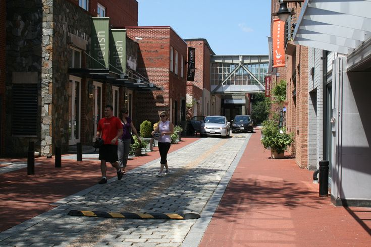 This shows a remade laneway in Washington DC. Note the medium-rise buildings, as are found near Commercial Drive. Its connecting laneways--perhaps even portions of the Drive itself--could be remade as places that are open for retail business, still navigable by cars, but which also have design elements that prioritize walking and cycling, e.g. speedbumps, good lighting, attractive pavements, better drainage; and elements that beautify and promote local culture [e.g. planters, banners]. ^LA