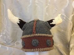 Viking Helm Hat - Free crochet helmet with horns pattern by Reckless Stitches. To go with this beard: http://www.ravelry.com/patterns/library/crochet-beard-viking-or-wizard
