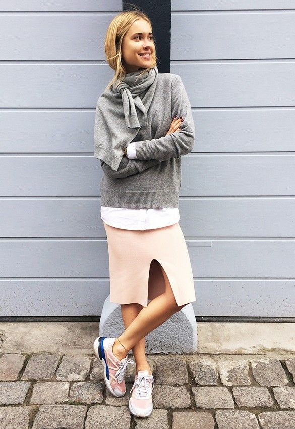 Sweater on sweater with a pink skirt and sneakers