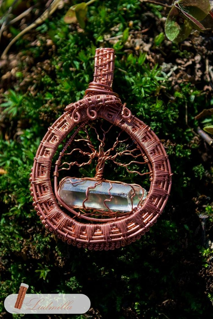 Wire wrap tree of life on quartz crystal