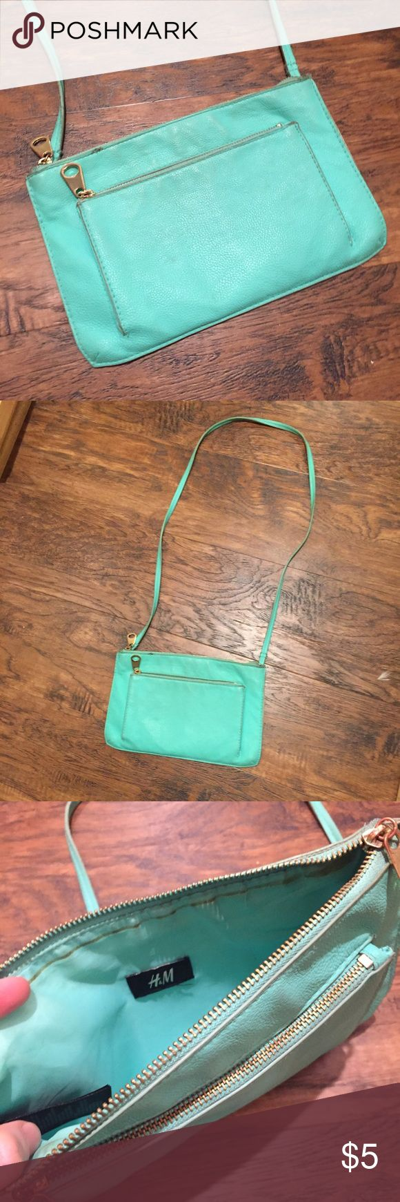 Mint green crossbody bag. H&M purse vegan leather Adorable mint green cross body purse from H&M. Gold hardware. Small pouch on the side and larger on the tip. Zippers work great! H&M brand, made with vegan leather like material. Used with some marks and wear but lots of life left :) H&M Bags Crossbody Bags