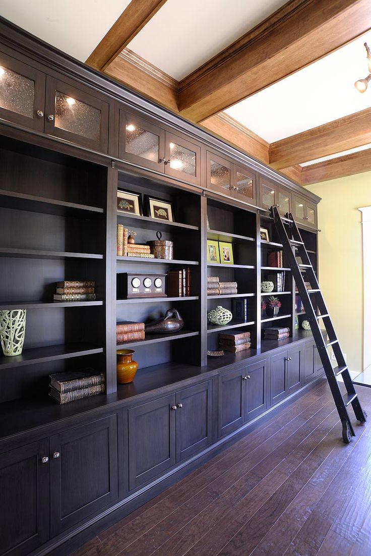 Mullet Cabinet - Dark stained Library Shelving with a sliding ladder and lighted upper glass cabinets.