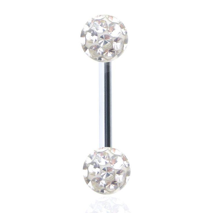 Piercing de langue avec barre en acier chirurgical et boules en cristal de Swarovski protégés par une résine.