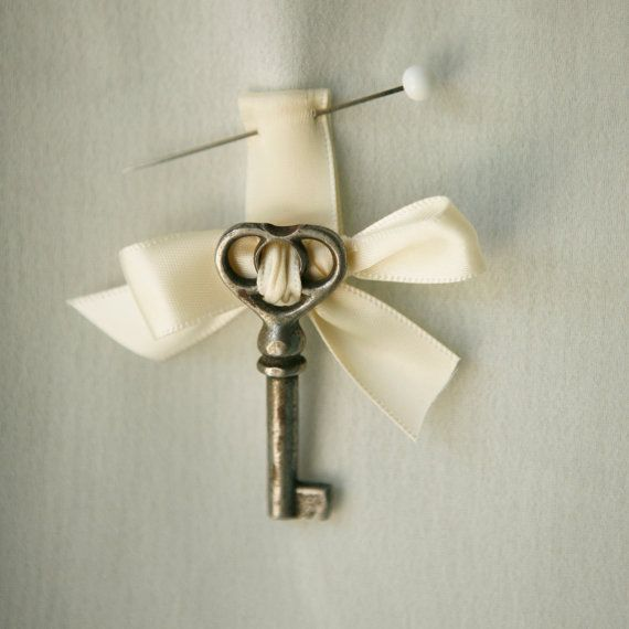 Key boutonniere, Something different for the groom. He wears a key on his boutonnière and She has the lock the key fits on her bouquet