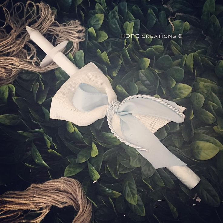 Palm Sunday 2016 Wrapped in flocked power blue paper , with natural eggshell white and powder blue ribbon. Finished off with Royal cording. All candles come with wax protectors X