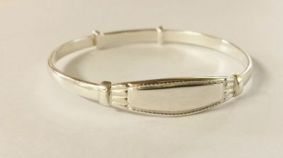 What we wanted:  A baby bangle... that expands... can be personalised... is available in all metals... is of great quality... and is suitable for boys or girls.   The clever elves came up with the perfect solution. We called it The Windsor.  We think it is set to become a classic!   Custom made in Australia for a precious little person you know.