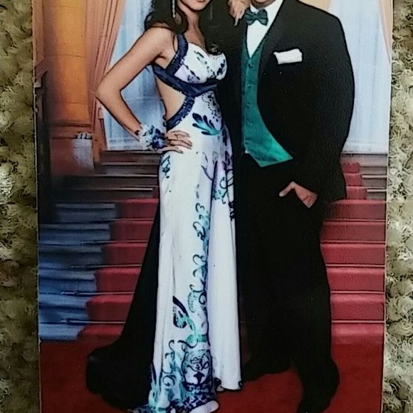 Group USA Prom Dress *Unaltred *Padded bust *Navy and white *Open back *Navy train *Zipper on side *will also fit from size 0-4 (my other daughter is a size 4 and it fits) *50inches long from under arm to bottom front *Worn once by daughter to senior prom *Last picture shows only flaw, front right side has a small snag but not very noticeable *additional pics in another post Morgan & co ✅Questions✅Bundle✅Offers Morgan & Co. Dresses Prom