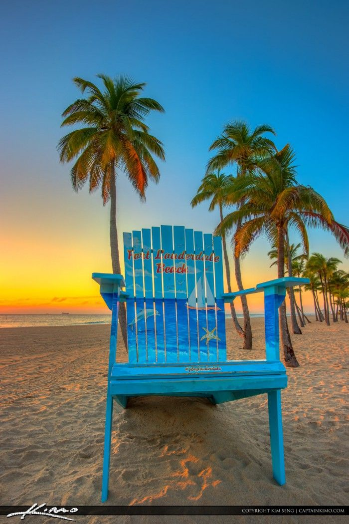 Super gorgeous sunrise from Fort Lauderdale Beach with the big beach chair and some coconut trees. HDR image created using Photomatix Pro and Topaz software.