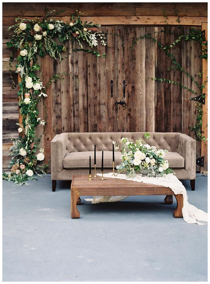... Area Featuring Barn Doors With Floral Garland, A Cozy Tufted Sofa And A  Coffee Table With Soft Florals. Event Design By Love U0026 Honey, Florals By  Nectar.