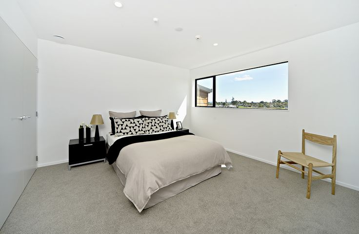 Simple and spacious bedroom inside the modern family houses at the new Auckland development in Hobsonville Point