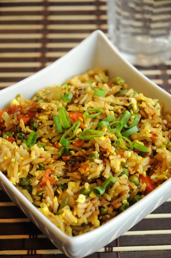 Best Ever Vegan Fried Rice with Scrambled Tofu // rice, firm tofu, turmeric, nutritional yeast, onion powder, olive oil, garlic, carrot, frozen peas, spring onions, soy sauce, liquid smoke, sesame oil, rice wine vinegar, brown sugar, sriracha